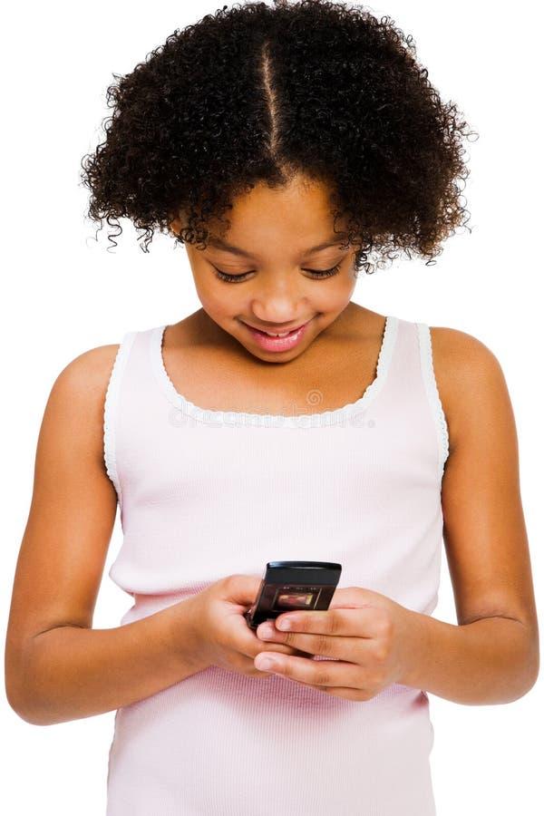 Envio de mensagem de texto da menina imagem de stock royalty free