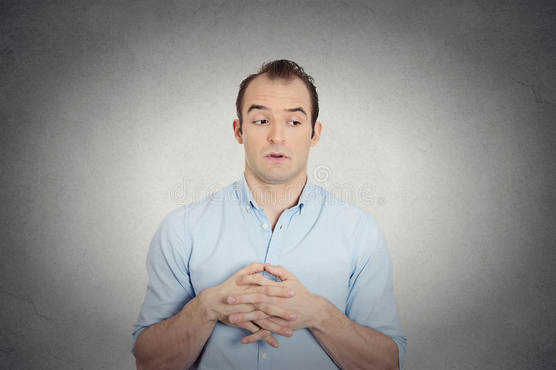 Envious, guilty, sly young business man royalty free stock images