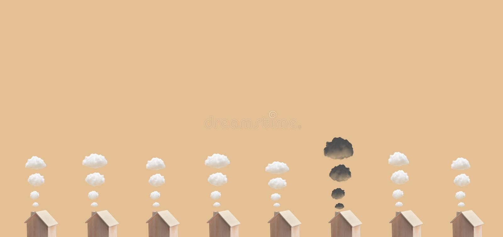 Environment and clean power concepts with wood house model and clean,dark smoke on space background.Global warming stock image