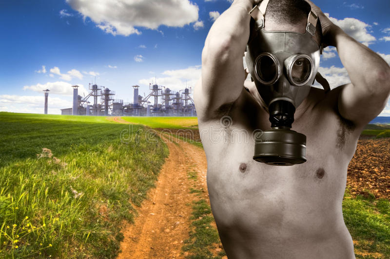 Environment concept, urban land and nude man. With gas mask stock images
