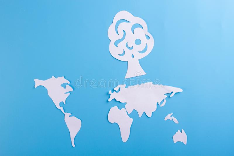 Environment conservation concept. World map and green tree royalty free stock images