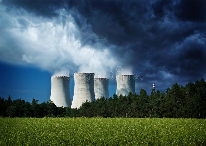 Environment, nuclear power station. Environment and industry, stormy sky above nuclear power station, background stock photos