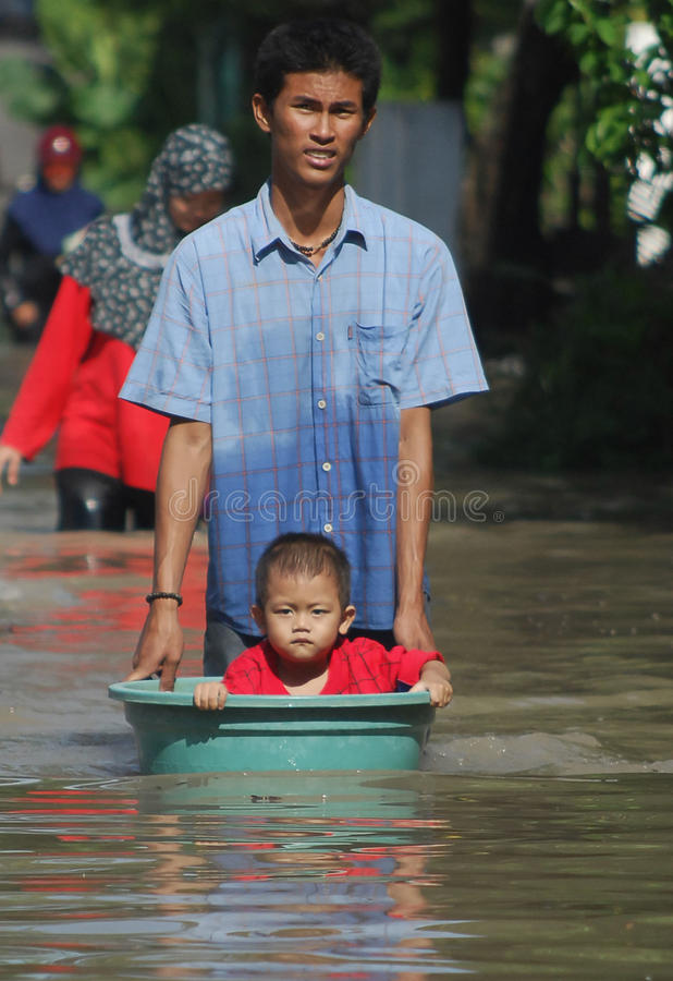 ENVIRONMENTAL DISASTER DAMAGE FLOOD. Heavy flooding caused by the stream of Bengawan Solo River, in Solo, Java, Indonesia. The environmental damages of the royalty free stock photo