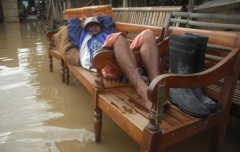 ENVIRONMENTAL DISASTER DAMAGE FLOOD. Heavy flooding caused by the stream of Bengawan Solo River, in Solo, Java, Indonesia. The environmental damages of the stock photo