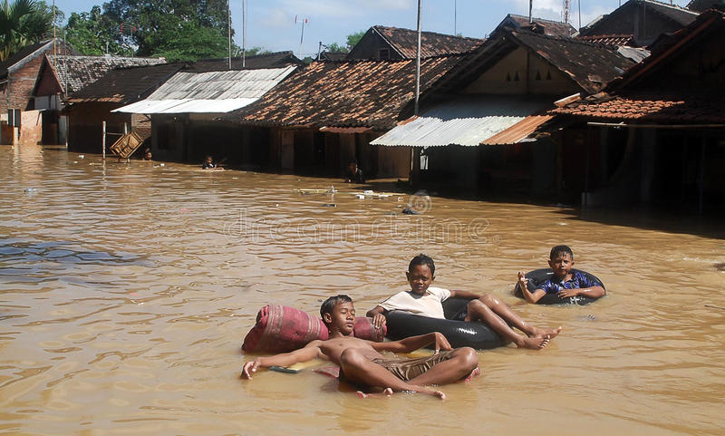 ENVIRONMENTAL DISASTER DAMAGE FLOOD. Heavy flooding caused by the stream of Bengawan Solo River, in Solo, Java, Indonesia. The environmental damages of the royalty free stock photography