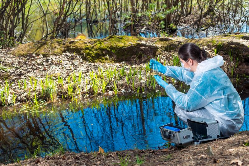 Environmental disaster, environmentalist chemist explores the water. In the forest river stock photo