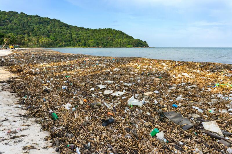 Environmental disaster. Garbage dump on Bai sao beach with white sand on the coastline. Plastic rubbish pollution in ocean.Plastic royalty free stock photos