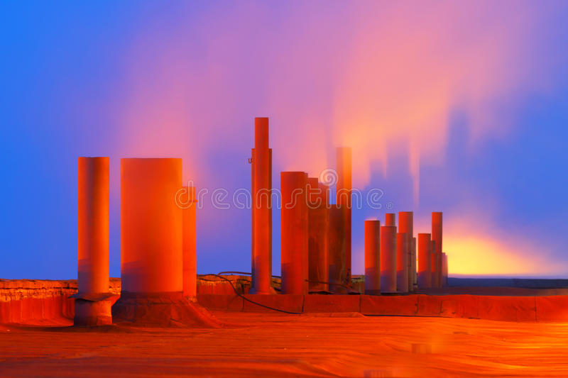 Environmental pollution.Industrial business.Smoking pipes. royalty free stock photo