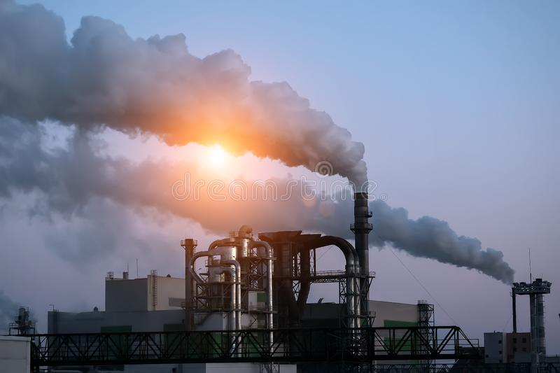 Environmental pollution.Industrial business.Smoking pipes. Urban landscape. stock photography