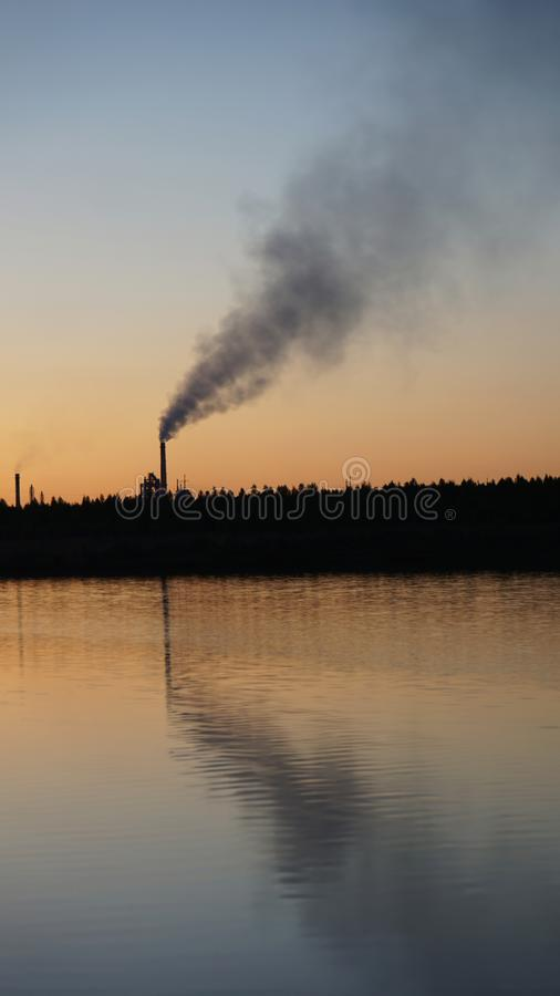 Environmental pollution pipe smoke water stock photos