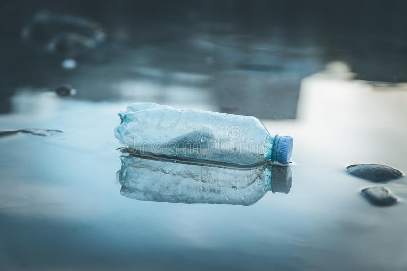 Environmental pollution: plastic bottle on the beach. Pollution waste plastic environmental protect bottle litter cleanup garbage trash urban water sea beach royalty free stock photos