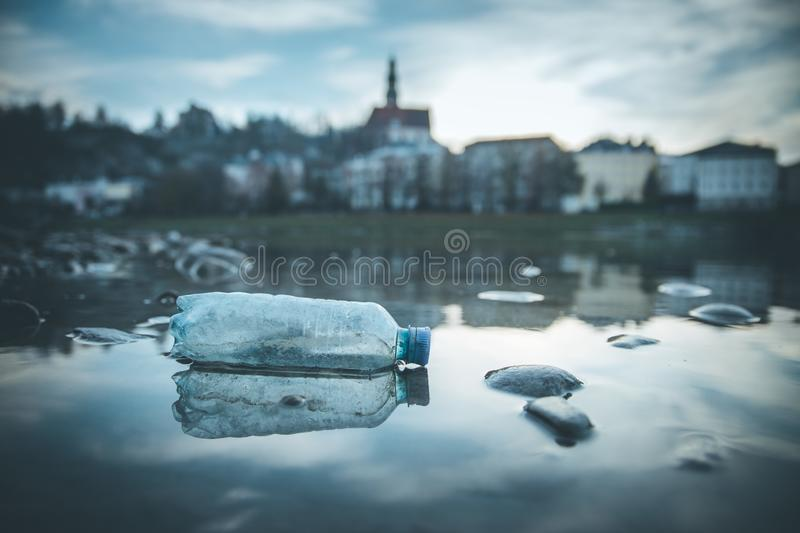 Environmental pollution: plastic bottle on the beach, urban city. Pollution waste plastic environmental protect bottle litter cleanup garbage trash urban water royalty free stock photos