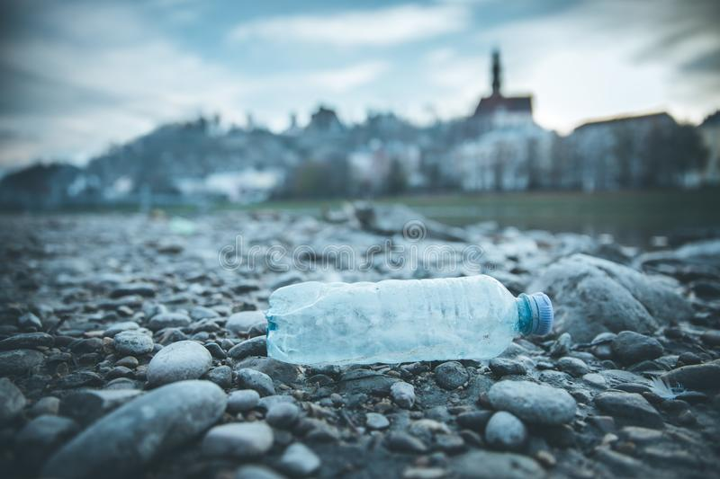 Environmental pollution: plastic bottle on the beach, urban city. Pollution waste plastic environmental protect bottle litter cleanup garbage trash sea urban stock images