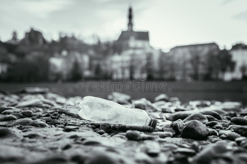 Environmental pollution: plastic bottle on the beach, urban city. Pollution waste plastic environmental protect bottle litter cleanup garbage trash sea urban royalty free stock photo