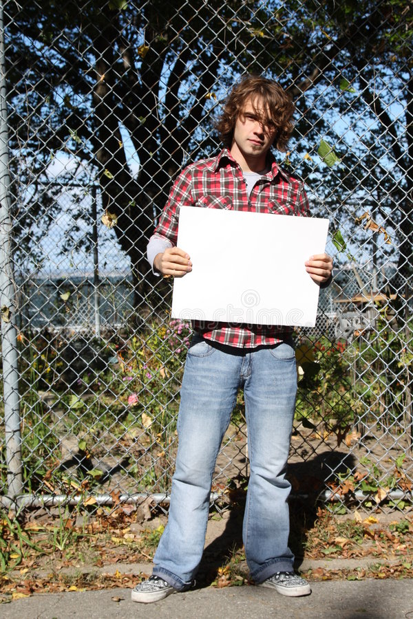 Environmentalist. Young male holding a blank sign - just put your own message stock photo