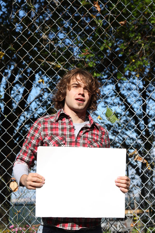 Environmentalist. Young male holding a blank sign - just put your own message stock image