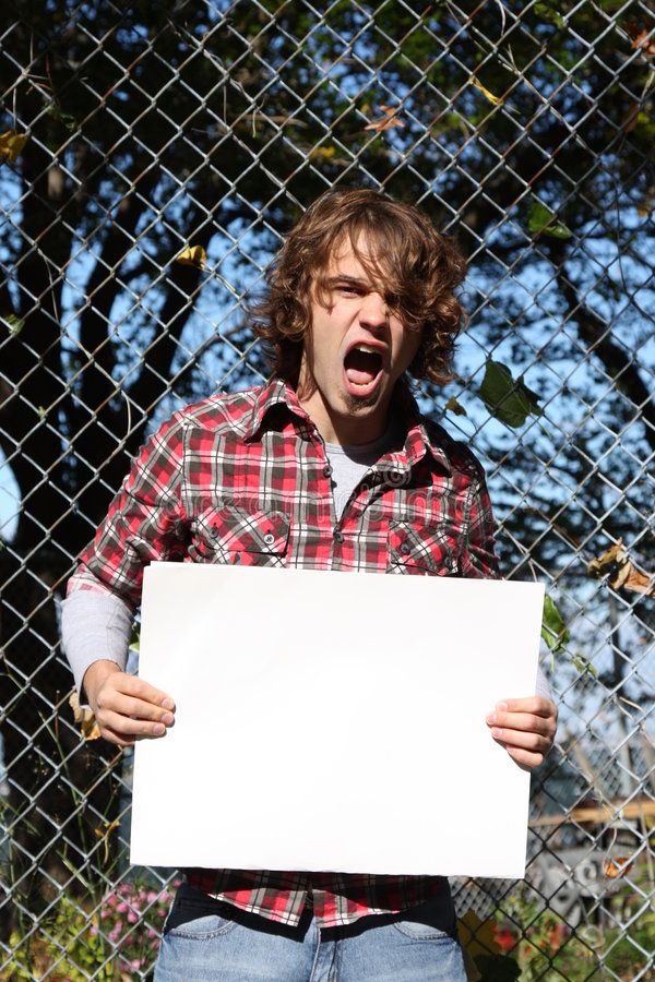 Environmentalist. Young male holding a blank sign - just put your own message stock images