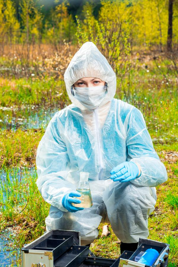 Environmentalist conducts water testing during. An epidemic royalty free stock photos