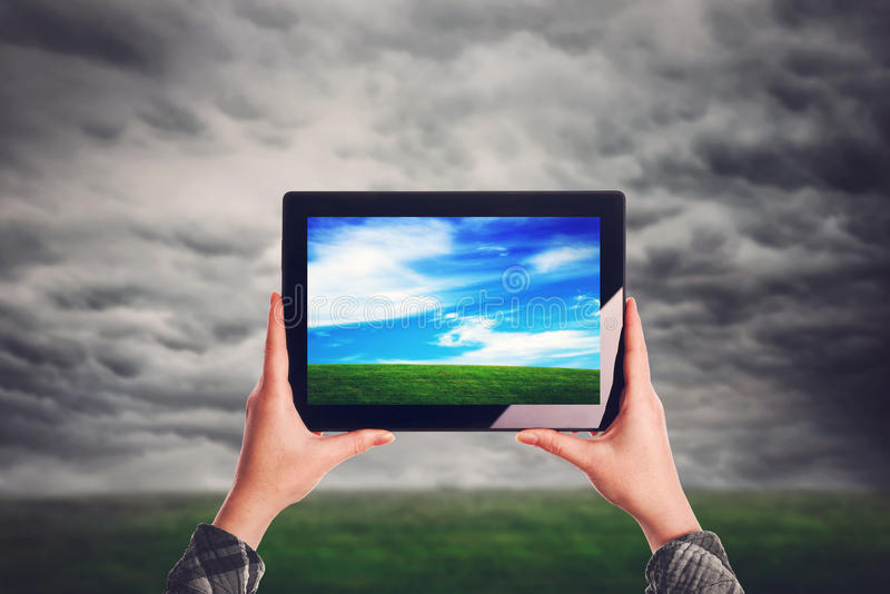 Environmentalist with digital tablet computer. Standing at open field royalty free stock image