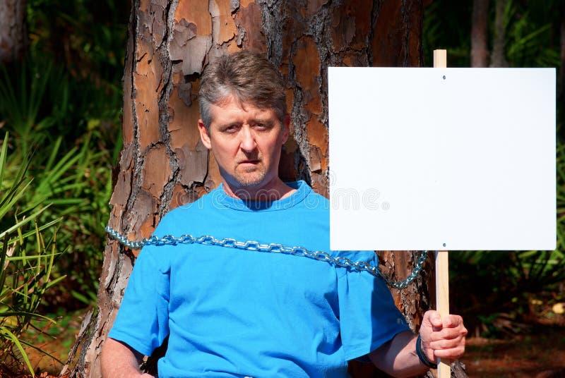 Environmentalist protesting deforestation stock images