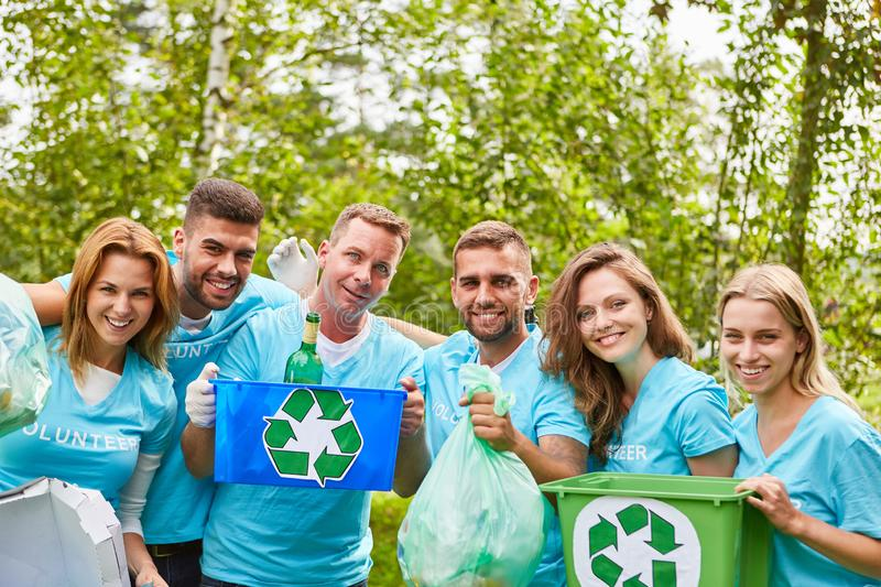Environmentalists collect waste for recycling. Young people as environmentalists collect waste for reuse and recycling stock images