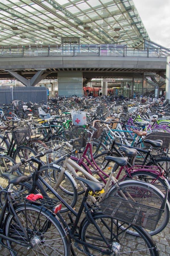Environmentally friendly transportation: Parked bikes in front of train station, Copenhagen, Denmark royalty free stock photo