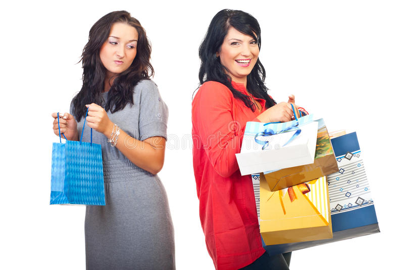 Envy woman. Envious woman on her friend with many shopping bags isolated on white background