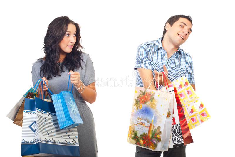 Envy woman on man shoppings stock photo
