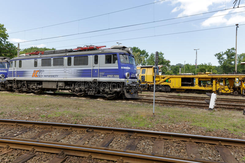 EP07 electric locomotive at the side track stock image