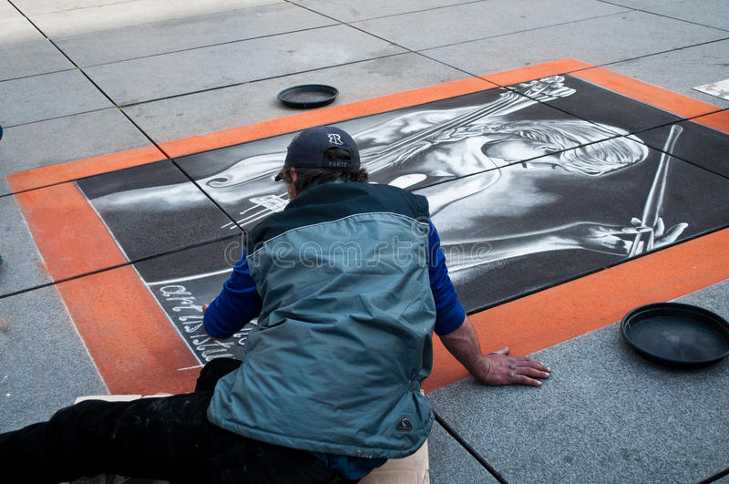 Ephemeral artist painter in the street of paris stock photography