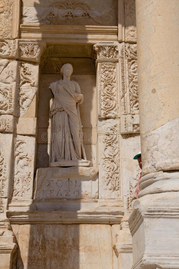 Ephesus EFES, TURKEY – 2016-Marble statue personification of wisdom Sophia placed in the niche onto the ancient building. Ephesus EFES, TURKEY – royalty free stock photo