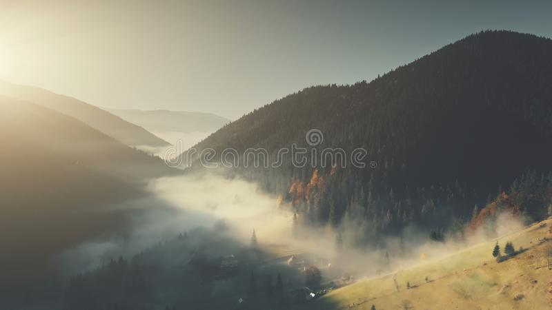 Epic chain hill forest slope landscape aerial view. Misty Evergreen Forest Mountain Scenery Wildlife Habitat Sight. Thick Fog Steep Rock Gorge Clean Ecology royalty free stock photos