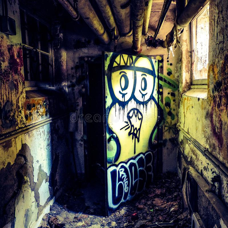 Epic colorful graffiti in old psych center royalty free stock image