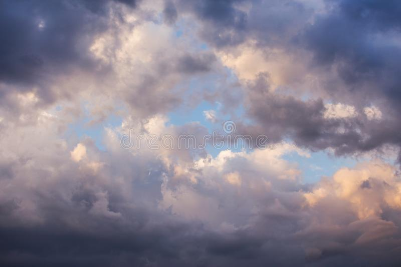 Epic beautiful cumulus fluffy white clouds in sunlight against blue sky background, texture stock images