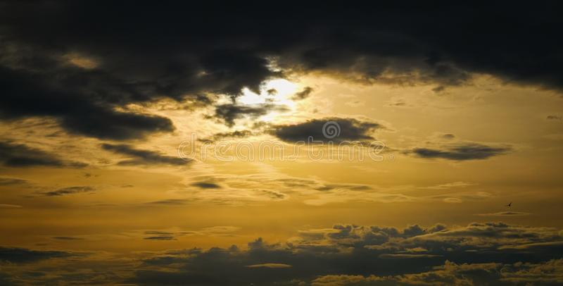 Epic dramatic sunset . Beautiful orange, yellow and black colors sunset sky for background, befor rain stock photography