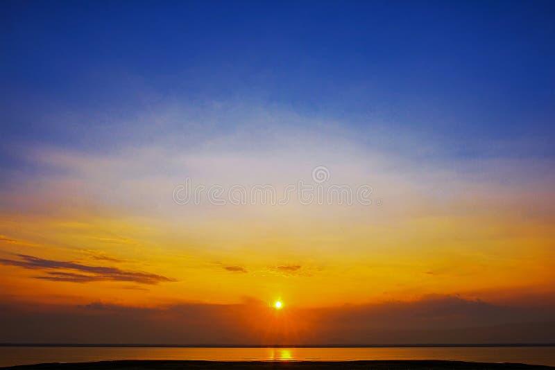Epic dramatic sunset beautiful  yellow orange and blue colors sunset sky stock photos