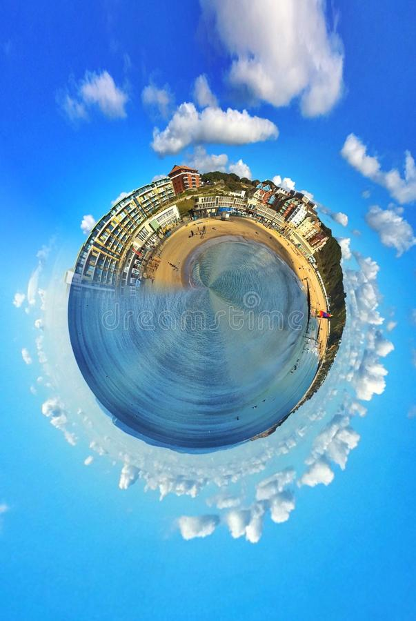 Epic mini planet with a beach stock photo