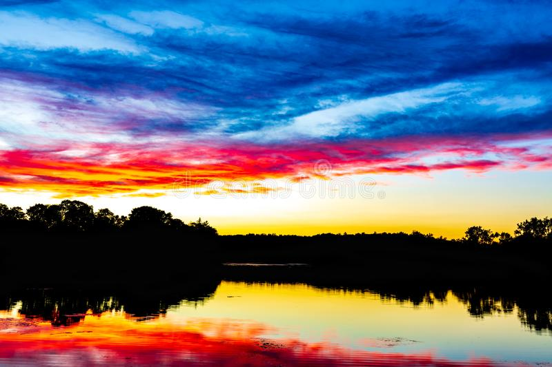 An epic New England Sunset - Ell Pond Melrose Massachusetts. Ell Pond is located in New England - Melrose Massachusetts. The pond offers stunning photo stock photo