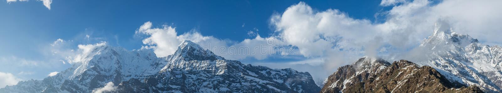 Epic panoramic landscape view of beautiful Himalaya mountains covered with snow at Mardi Himal trekking area. In Nepal stock photography