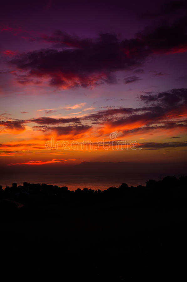 Epic Pastoral Seascape Sunset. Beautiful and epic cloudy sunset on a gorgeous pastoral land and seascape with mountains, capes and islands stock photography