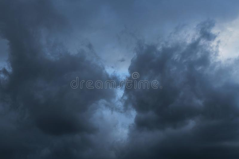 Epic Storm blue sky, dark clouds background texture. Epic Storm blue sky with dark clouds background texture royalty free stock photos