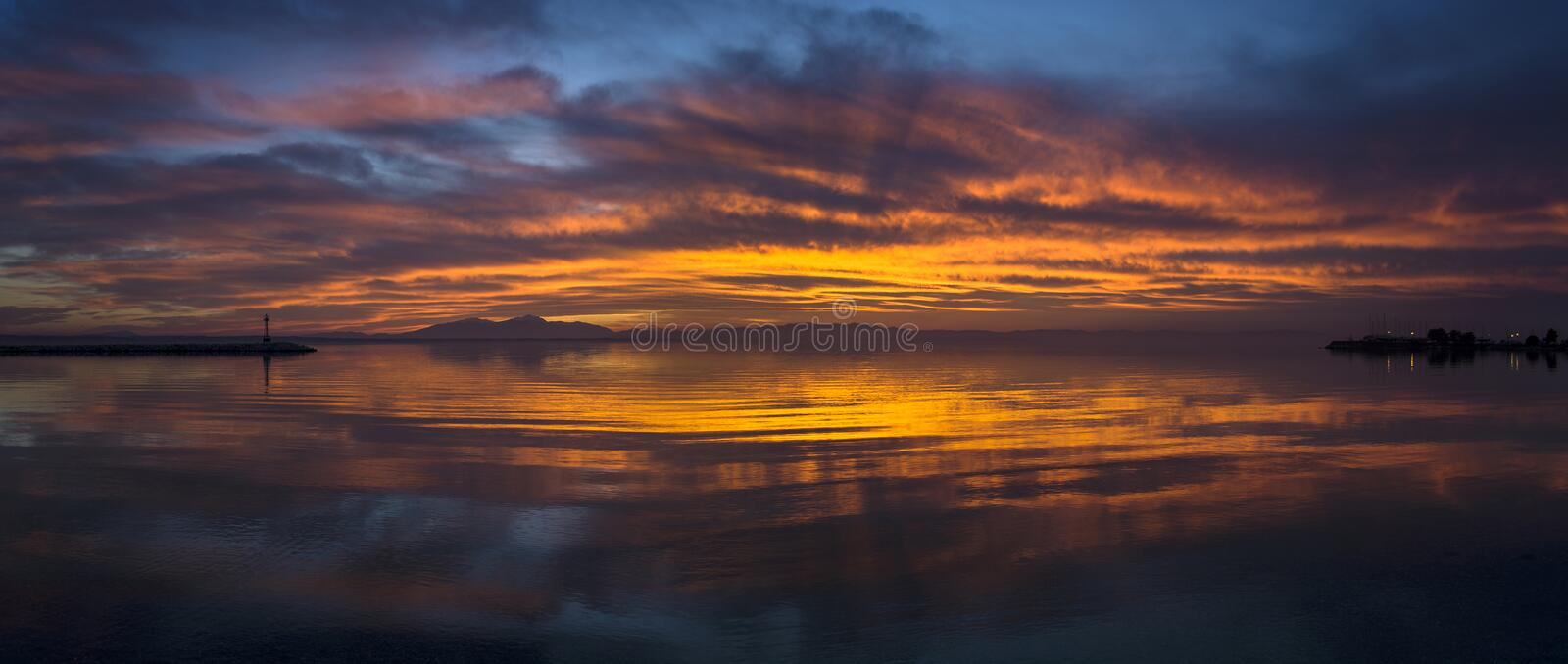 EPIC SUNSET WITH OLYMPUS MOUNTAIN AT THE BACKGROUND stock photo