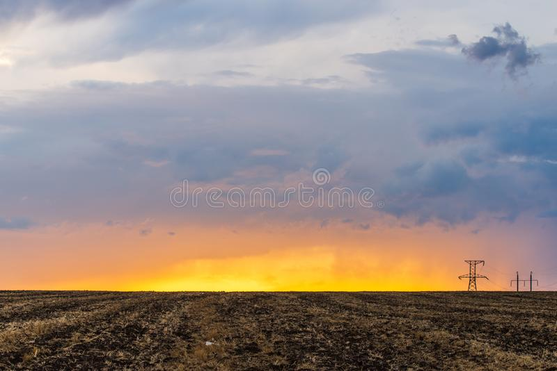 Epic sunset with rural landscape with high-voltage line royalty free stock photo