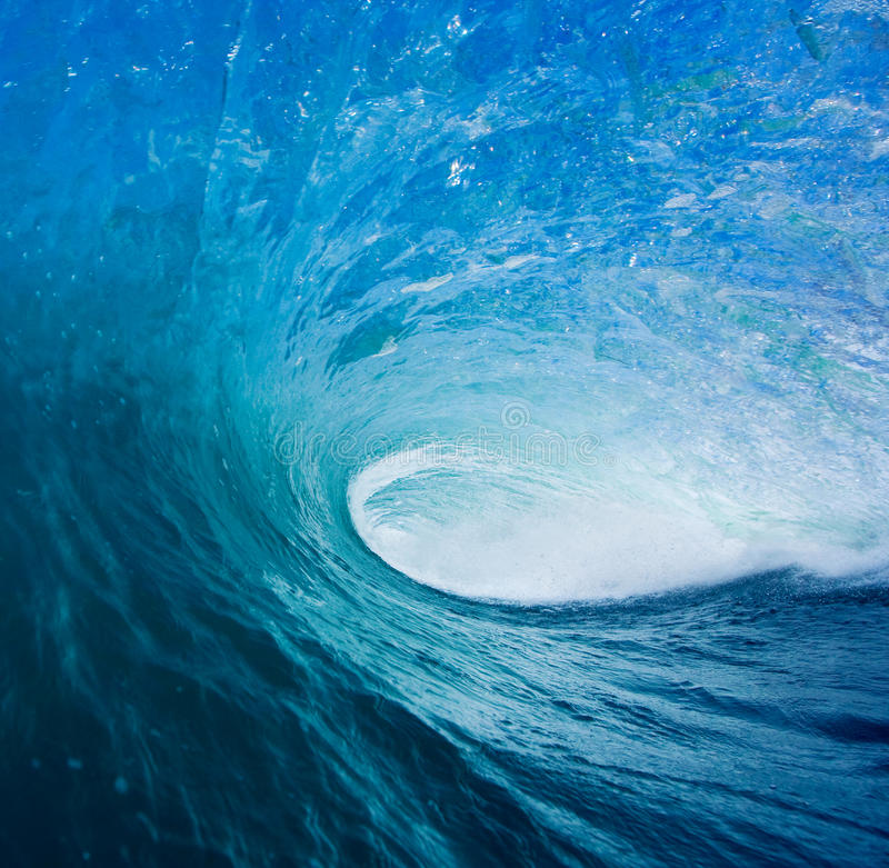 Epic Surfing Wave. Large Blue Surfing Wave Breaks in Ocean stock photos