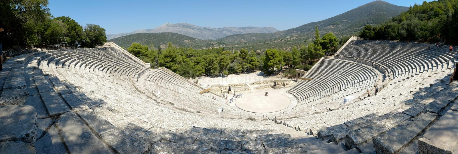 The Epidaurus Ancient Theatre is a theatre in the Greek old city of Epidaurus dedicated to the ancient Greek God of medicine, Ascl royalty free stock image