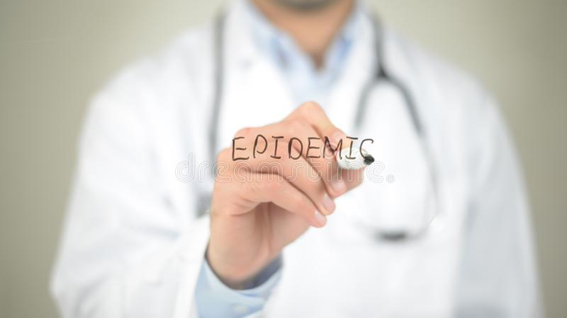 Epidemic, Doctor writing on transparent screen royalty free stock photography