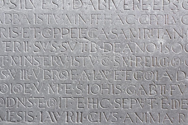 Epigraph. An ancient latin inscription on the marble slab stock photos