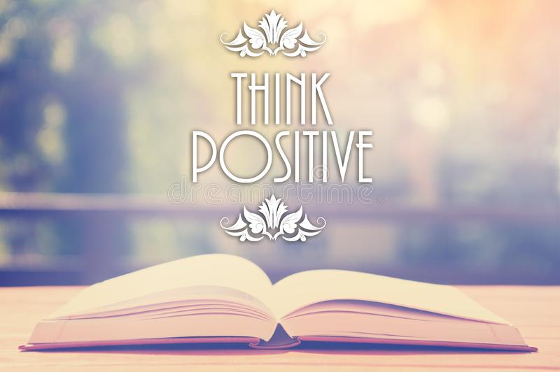 Epigraph over the opened book with elegant ornament - Think positive - Positive thinking concept - motivating set stock image