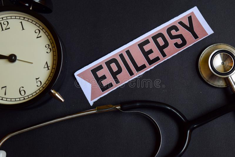 Epilepsy on the print paper with Healthcare Concept Inspiration. alarm clock, Black stethoscope. stock images