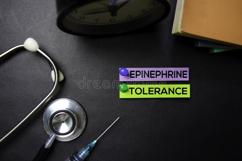 Epinephrine Tolerance text on Sticky Notes. Top view isolated on black background. Healthcare/Medical concept royalty free stock image